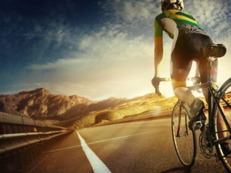 cyclist riding bike down a highway