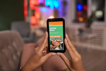 Woman orders food on a mobile food ordering application.